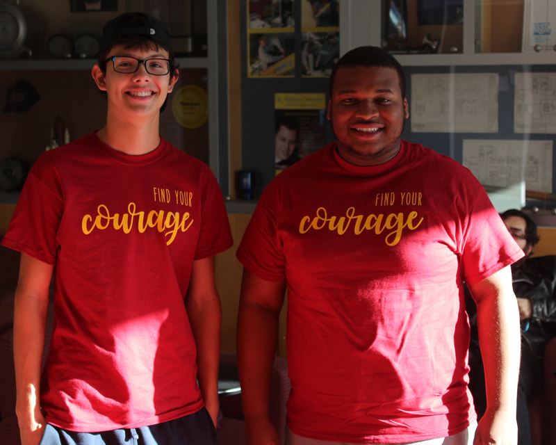 Two students wearing red T-shirts take part in inaugural Courage Day
