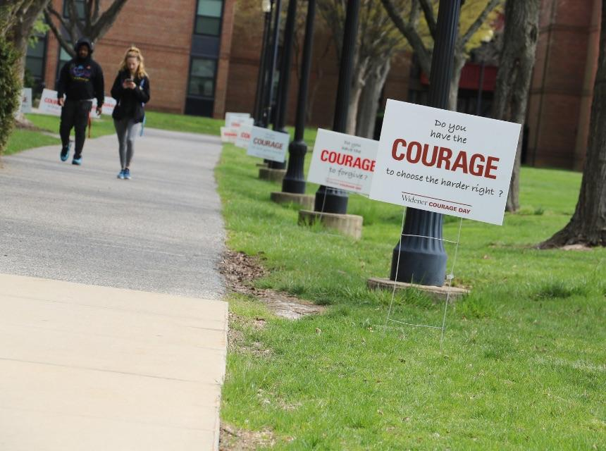 Courage Day signs and students on campus