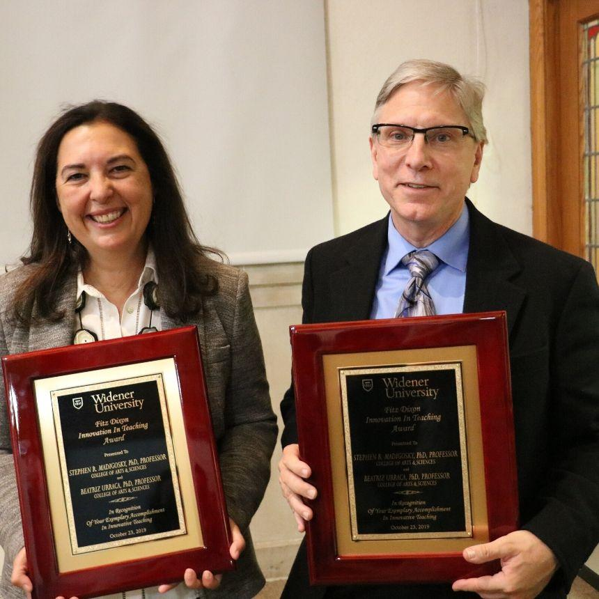 Beatriz Urraca and Stephen Madigosky hold their faculty awards