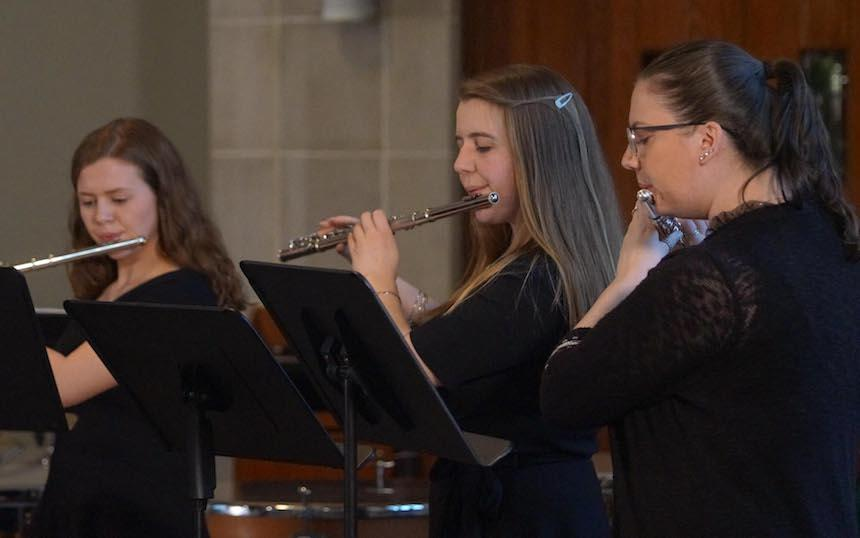 Widener Band Members Playing Flutes