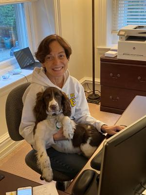 President Wollman works at home with her dog