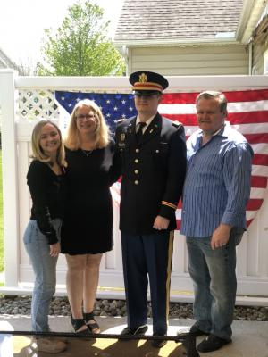 2nd Lt. James Hennelly with his parents and sister