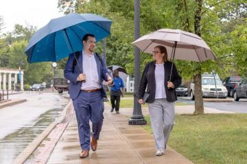 New trustee Domenic Colasante and Vice President Katie Herschede walk across campus.