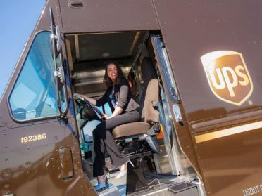 Aly Horton sitting in the driver's seat of a UPS truck