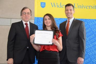 Annamarie Burns holds leadership certificate with two other people