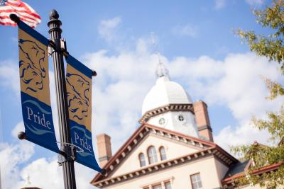 Widener Pride flags and Old Main building