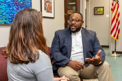 Master of Public Administration student Malcolm Yates speaking with an individual