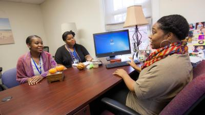 social work students discuss in office
