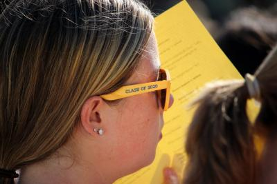 Student wearing yellow sunglasses that say 'class of 2020' on the side