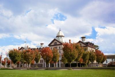 Old Main surrounded by fall foliage