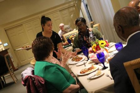 Hospitality management student serves dinner for fundraiser
