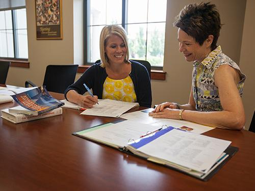 nursing student meets with faculty