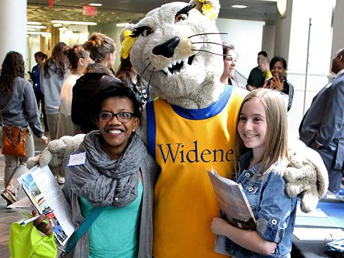 undergraduate students with mascot at open house