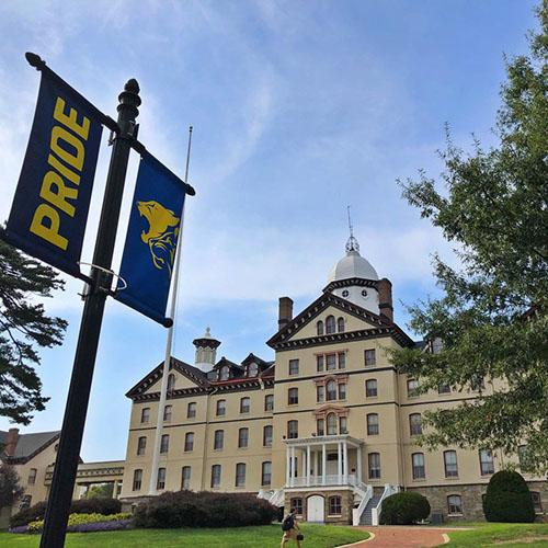 Widener University new Pride flags in front of Old Main historic building