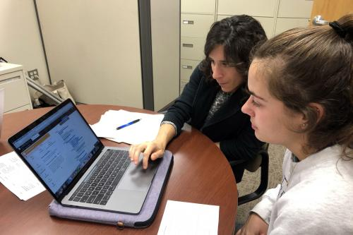 Career counselor works with student on their resume using VMock system