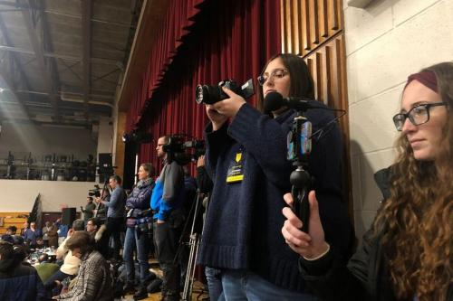 Students film at a political rally for the New Hampshire Primary