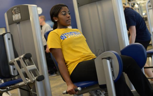 Student exercising in pride recreation center