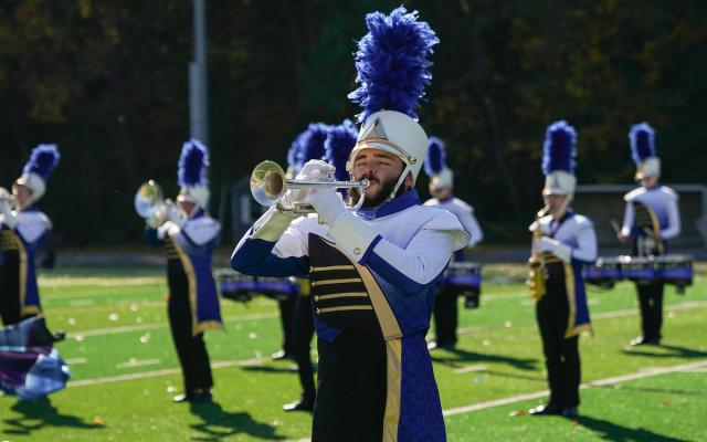 widener university marching band performs on football field