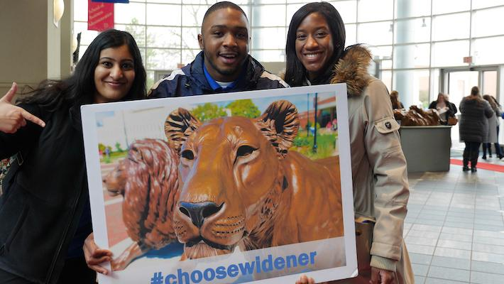 choose widener students with sign