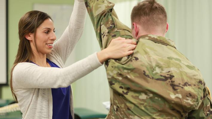 Graduate PT Student Working on ROTC Member