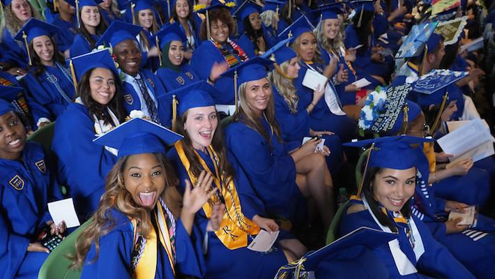 students celebrate commencement at mann center