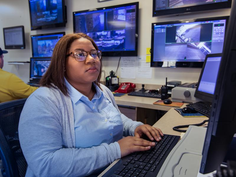 Samirah Thompson watches security cameras