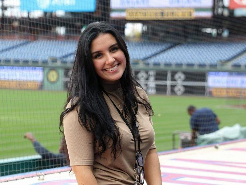 Jessica Feoli sits in the Phillies baseball stadium