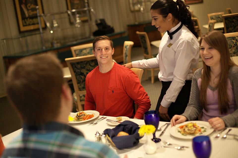 students serve fine dining experience in Marriott Dining Room